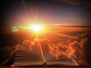 sunrise light burst holy bible prophetic book in clouds